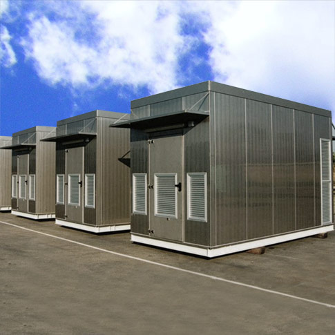 Environmental telecommunications shelter with small front and rear roofing - Series Shelter Modules
